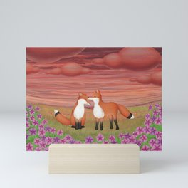 affectionate foxes and purple petunias Mini Art Print