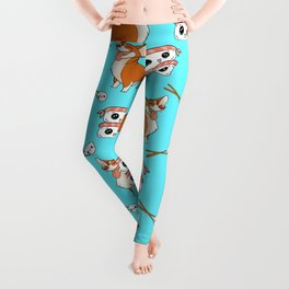 Cute cuddly funny baby corgi dogs, happy cheerful sushi with shrimp on top, rice balls and chopsticks pretty light pastel baby blue pattern design. Leggings