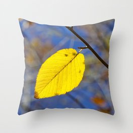 Yellow leaf against blue sky Throw Pillow
