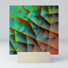 Abstract bright pattern of green and overlapping blue triangles and irregularly shaped lines. Mini Art Print
