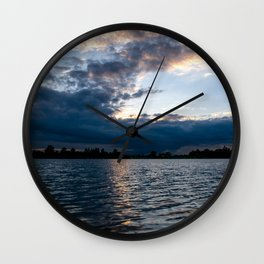 Sunset over a lake Wall Clock