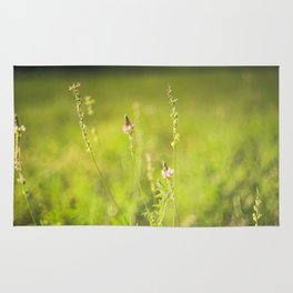 Wild flowers in the green meadow Rug