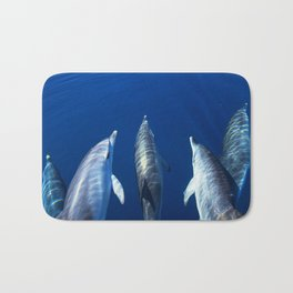 Playful and friendly dolphins Bath Mat