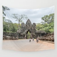 bikes Wall Tapestries featuring Angkor Thom South Gate with Tourists on Bikes, Cambodia by Jennifer Stinson