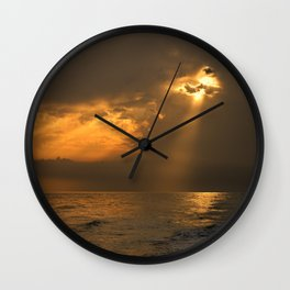 Gold through the clouds Wall Clock