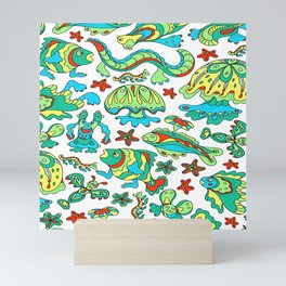 A pattern of fancy bizarre sea creatures. Style Doodle. Vector illustration. Mini Art Print