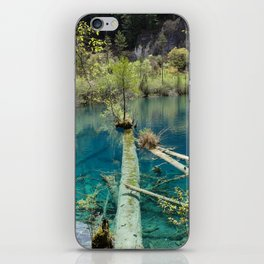 Blue water lake surrounded with greenery iPhone Skin