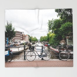 Bicycles in Amsterdam canal Throw Blanket