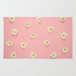 pink background and daisies Rug