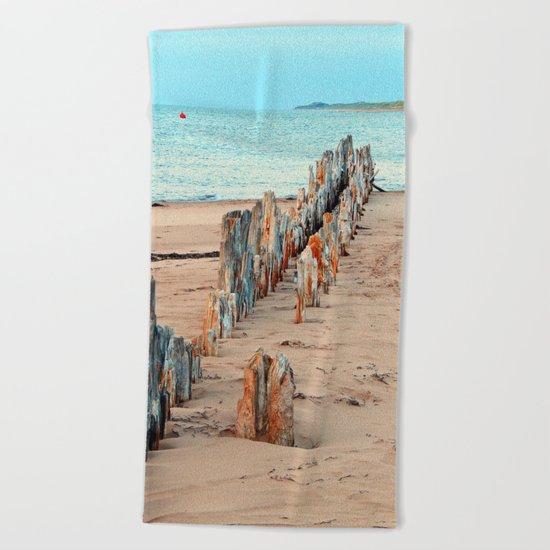 Wharf Remains on the Beach Beach Towel