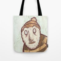 hockey Tote Bags featuring Hockey Yeti by Kip Noschese