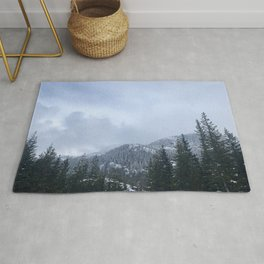 Snowy Peaks Above a Green Forest in Victoria, B.C. (Canada) Rug