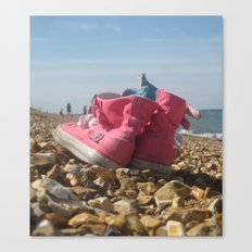 Pink shoes relaxing on the beach Canvas Print