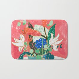 Bouquet of Flowers in Alexandrite Inspired Vase against Salmon Wall Bath Mat