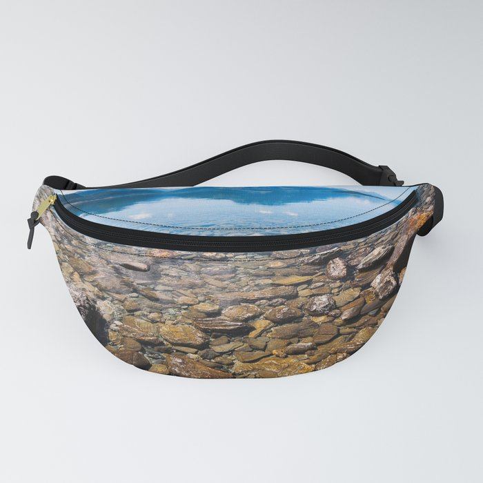 Snow-capped mountains view in summer from the rocky shore of lake Wakatipu. Fanny Pack