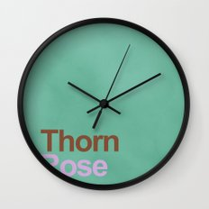 A rose between two thorns Wall Clock