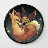 eevee Wall Clocks featuring Eevee and Vulpix by Yamilett Pimentel
