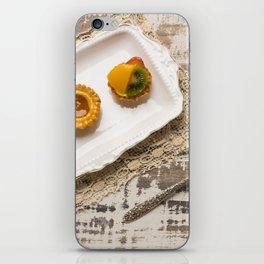 Three fruit tarts presented on an elegant antique china plate iPhone Skin