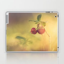 Macro shot of cowberry growing in forest Laptop & iPad Skin