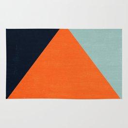 mod triangles - autumn Rug