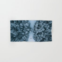 Man lying in the snow on a frozen lake in a winter forest - Landscape Photography Hand & Bath Towel