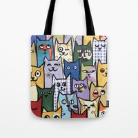 a lot of cats Tote Bags featuring Cats a Lot by grrrenadine