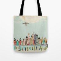 minneapolis Tote Bags featuring visit minneapolis minnesota by bri.buckley