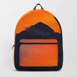 Stunning vibrant sunset behind mountain Backpack