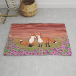 affectionate foxes and purple petunias Rug