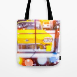 yellow classic taxi car with colorful bokeh light abstract background Tote Bag