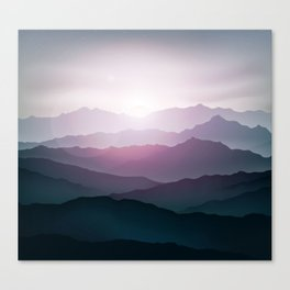 dark blue mountain landscape with fog and a sunrise and sunset Canvas Print