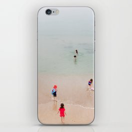 Children on the beach iPhone Skin