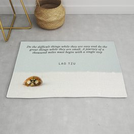Lao Tzu Quote | A journey of a thousand miles must begin with a single step Rug