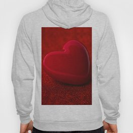 The red Heart shape on red abstract light glitter background Hoody
