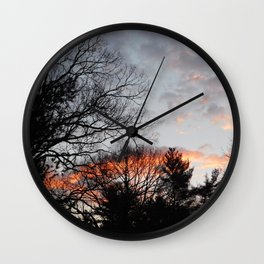 red clouds in the sky Wall Clock