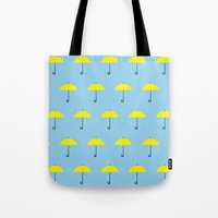 himym Tote Bags featuring HIMYM Yellow Umbrella by tralalavelling