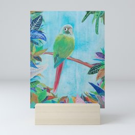 a bird and colorful leaves Mini Art Print