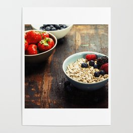 Bowls with cereals and fresh berries on wooden table Poster