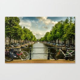 Bikes over a canal bridge in Amsterdam Canvas Print