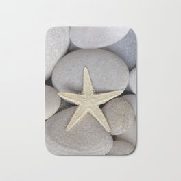 Starfish on pebble Bath Mat