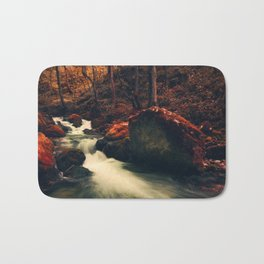 Surreal forest, river flowing in a red autumn looking forest Bath Mat