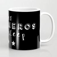 superheros Mugs featuring Even Superheros Need Sleep by Nina & Charlotte