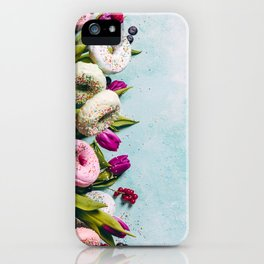 Sweet and colourful doughnuts with sprinkles, purple tulips and berries iPhone Case
