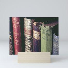 Vintage low light photography of books Mini Art Print