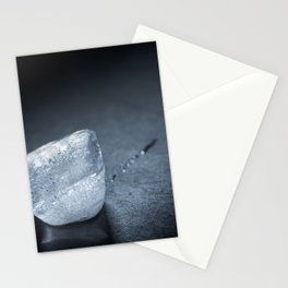 a cube of ice that melts Stationery Cards