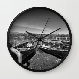 Rowing boats on shore of Lake Derewentwater in English Lake District Wall Clock