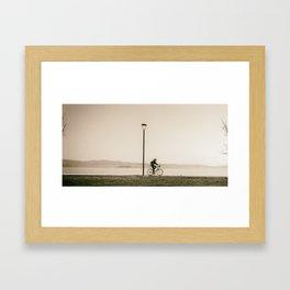 Cycling along the shore of lake Trasimeno Framed Art Print