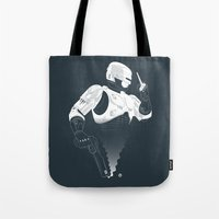 robocop Tote Bags featuring Robocop by Alain Bossuyt