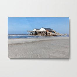 House on stilts at the beach of St. Peter Ording Metal Print