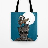 groot Tote Bags featuring Rocket & Groot by mebz art